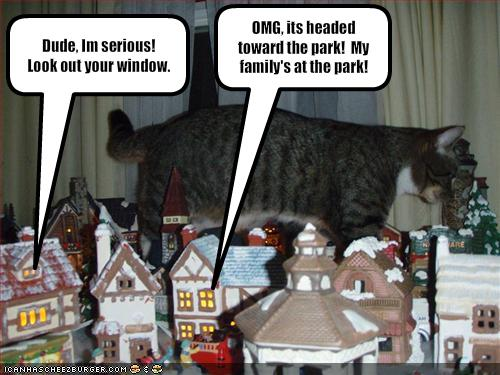 Funny-pictures-giant-cat-destroys-a-village